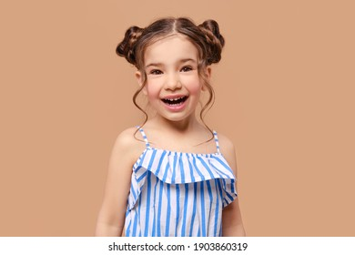 Portrait of cute young girl in sundress screaming in studio