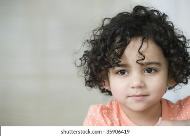 Portrait of a cute young hispanic girl smiling