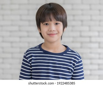 Portrait of cute young kid Asian boy with smile face