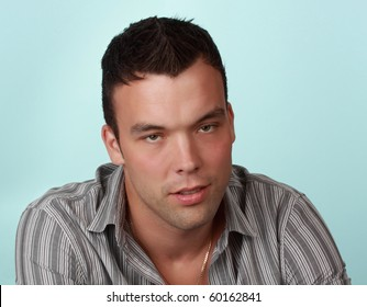 portrait of a cute young man, blue background