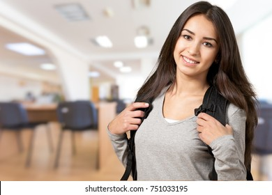 Portrait of a cute young student girl , isolated on background