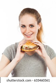 Portrait of a cute young woman holding a burger, isolated on white