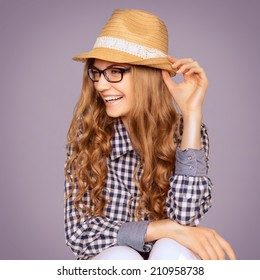 Portrait of a cute young woman wearing retro clothes and reading glasses