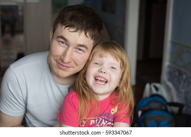 Portrait of a dad with his daughter close-up. A happy family. Adult man and a little baby girl. Smile.