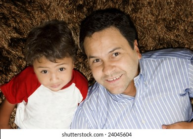 Portrait of dad playing with his little son