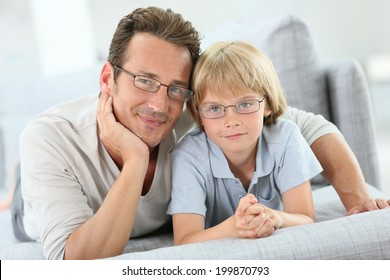 Portrait of daddy and son wearing eyeglasses