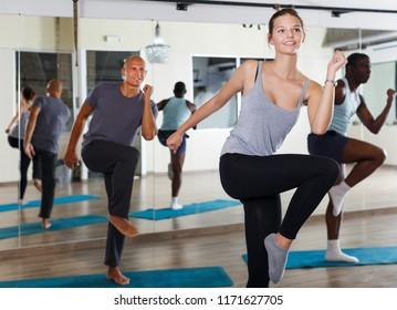 Portrait of dancing people practicing vigorous swing in dance studio