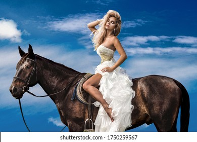 Portrait of a dark horse and woman. Beautiful glamour woman with a horse. Portrait of a beauty blonde bride in wedding dress with horse.