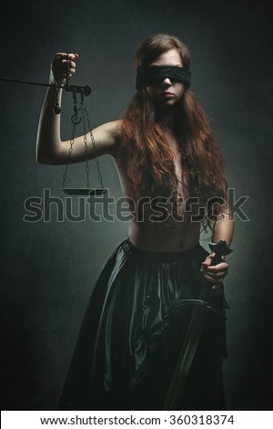 Portrait of a dark justice goddess with sword and scales. Mythology and fantasy
