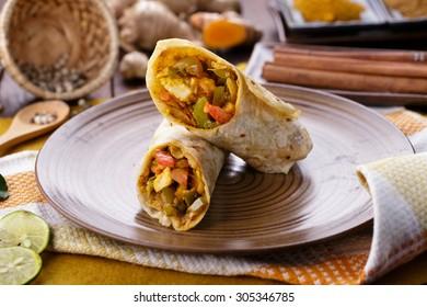portrait of delicious spicy indian wrap paneer tikka