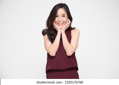 Portrait of delighted Asian woman smiling and dreamy expression, Happy beautiful girl holding her cheeks with a laugh, Thai model