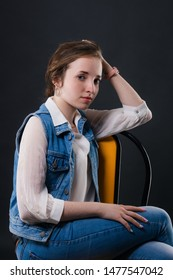 Portrait of a delightful business girl sitting on a chair