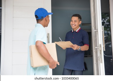 portrait of delivery male service delivering package