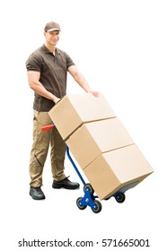 Portrait Of A Delivery Man Holding Trolley With Cardboard Boxes On White Background