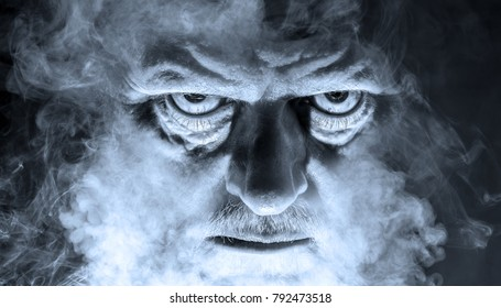 the portrait of a demonic looking man surrounded by fog