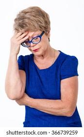 Portrait of depressed senior Caucasian woman, white background