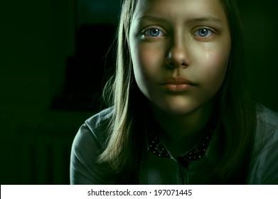 Portrait of a depressed teen girl, studio shot