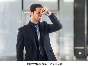 Portrait of a desperate businessman