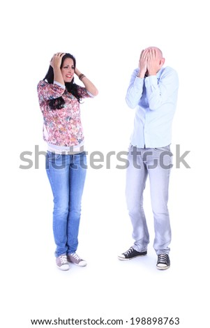 Portrait of desperate couple isolated over white background