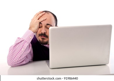 Portrait of a desperate young man looking at laptop against white background.