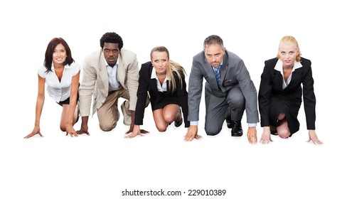 Portrait of determined multiethnic businesspeople ready to race against white background