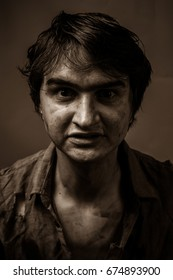 Portrait of a dirty man in sepia