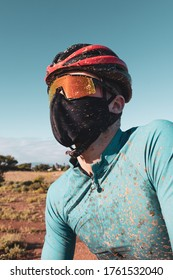 portrait of a dirty mountain biker wearing a face mask in the fight against COVID19 and corona virus