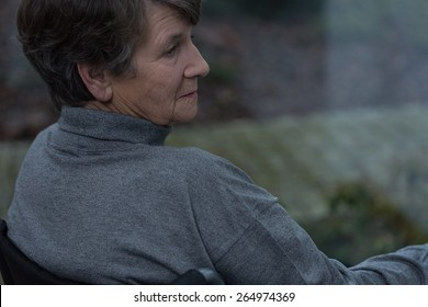 Portrait of disabled pensioner suffering for depression