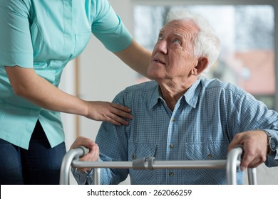 Portrait of disabled senior in care home