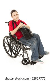 Portrait of disabled teen boy in his wheelchair.  Full body isolated.  Serious expression.