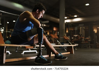 Portrait of disabled young man in the gym. Disabled sportsman Concept.