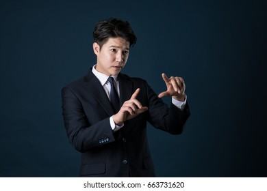 A portrait of a disgruntled Asian office worker