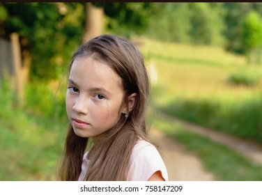 Portrait displeased pissed off angry teen girl with bad attitude, looking at you Negative human emotion facial expression feeling