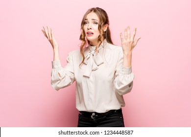 Portrait of displeased upset female frowns face as going to cry, being discontent and unhappy as cant achieve goals, isolated over pink studio background. Dissapointed young woman has troubles