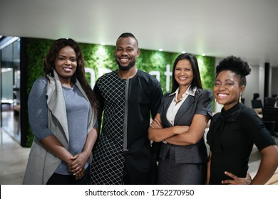 Portrait of a diverse group of smiling young African businesspeople standing together in the lobby of a modern office