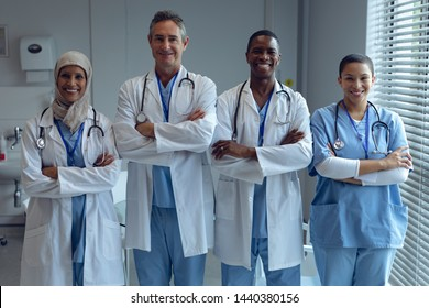 Portrait of diverse medical team standing with arms crossed in hospital