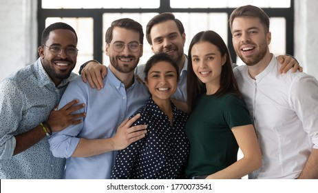 Portrait of diverse multi ethnic company staff, successful employees friendly associates standing in office photo shooting for business corporate album. Concept of hr, promotion advance, career growth