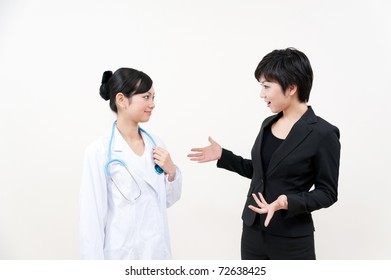 a portrait of doctor and businesswoman talking each other