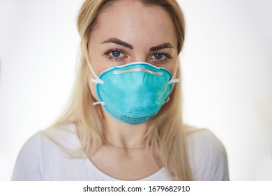 Portrait of a doctor fighting against COVID-19 isolated on a white background. Doctor wearing protection face mask against coronavirus.
