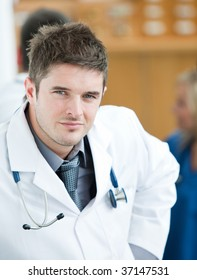 Portrait of doctor with his medical team in the background