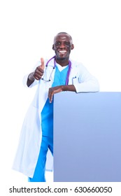 Portrait of doctor showing you ok sign standing in a white uniform on isolated background