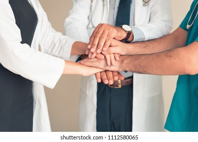 Portrait of doctor team joining hands stacking and handshake together., Unity and teamwork concept.