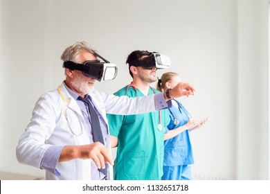 Portrait of doctor team are using virtual reality technology to examination physical body patient., Technology and occupational concept.