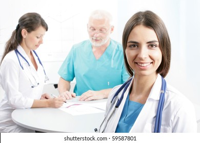 Portrait of a doctor with two of her co-workers