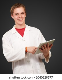 Portrait of a doctor using a tablet on black background