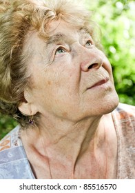 Portrait of a dreaming senior woman outdoor
