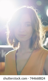 Portrait of dreamy pretty girl with natural makeup in backlight