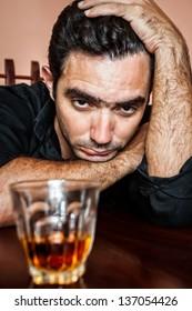 Portrait of a drunk and depressed hispanic man
