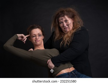 portrait of drunk two women over black background