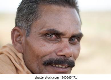 Portrait drunk villager - MAY 20th 2015; JEYPORE - INDIA